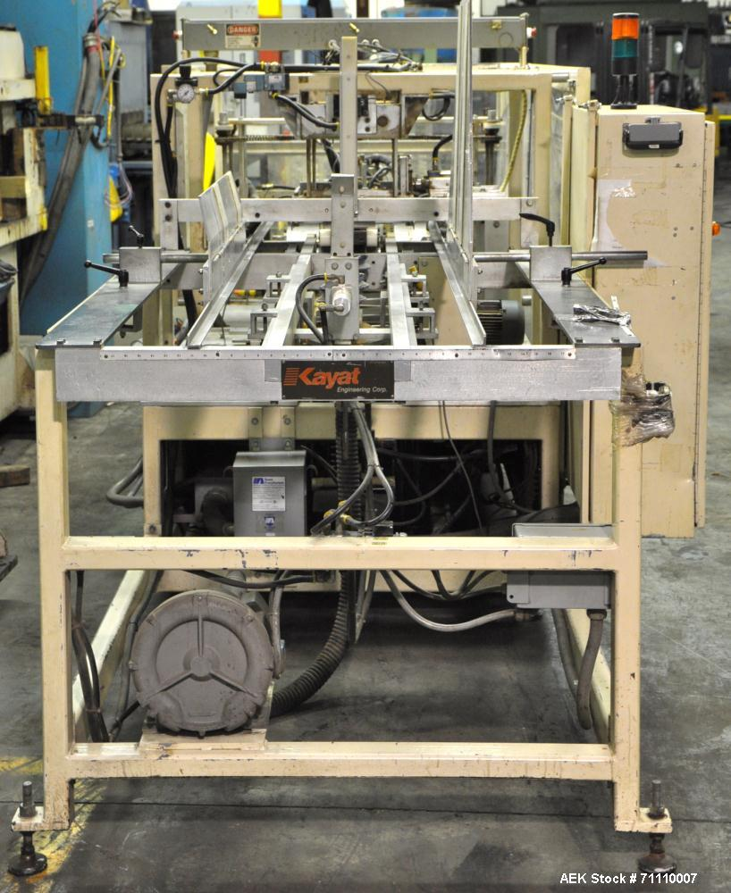 Used- Kyat Cartoner, Model PTF-28-RH.  PLS 5000 controls, A and B controller.  Infeed conveyor system.  Manufactured 1994.