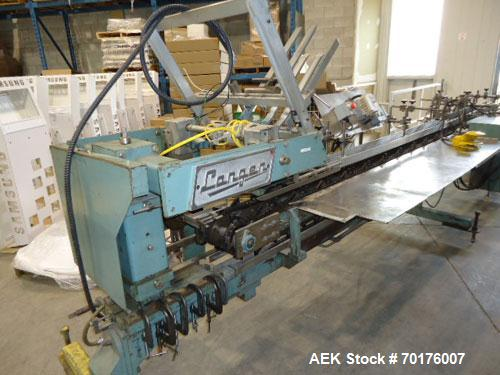"Used-Langen Model B1 R9 Horizontal Hand Load Cartoner.  Set on 9"" centers.  Has Valco/Melton hot melt system.  Electric 3/60..."