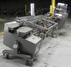 Used- Langen Model B1 Semi-Automatic Horizontal Cartoner capable of speeds up to 120 cartons per minute. Has 9