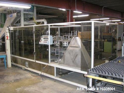 Used: Triangle Model VCL-1500 Continuos Motion Vertical Cartoner