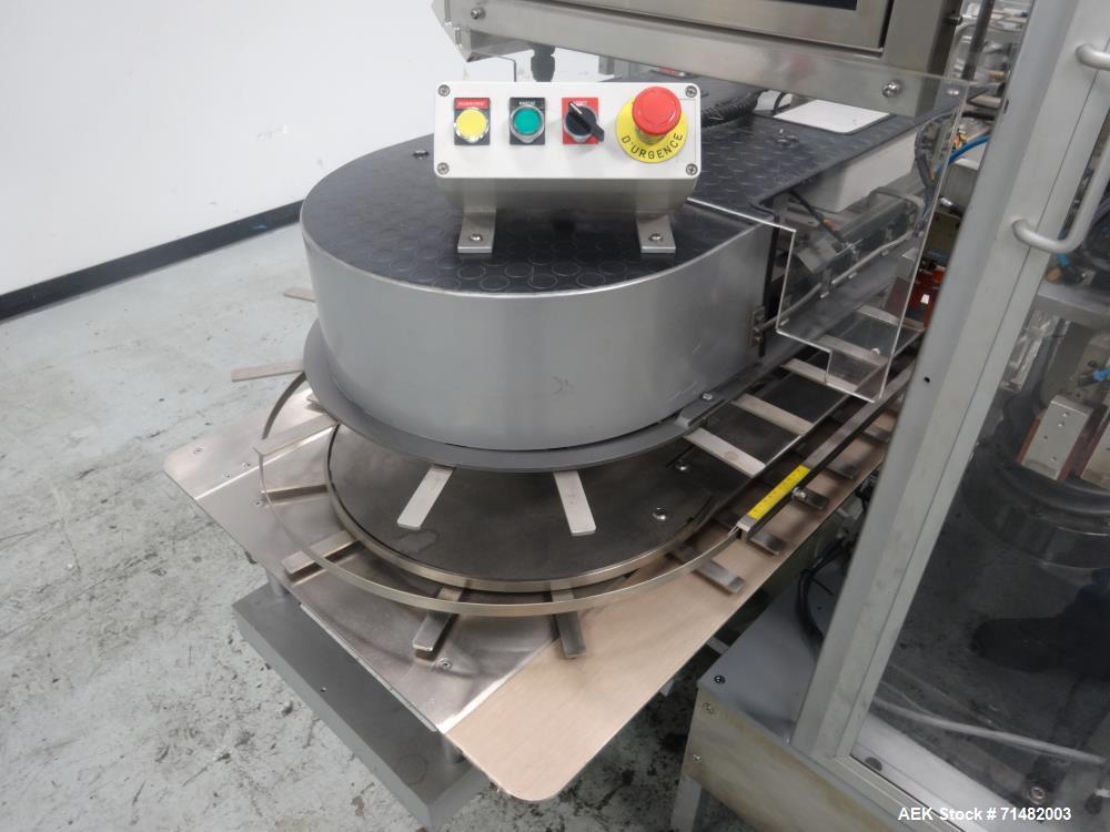 Used- CAM Model AV Vertical Cartoner With Automatic Bottle Loader