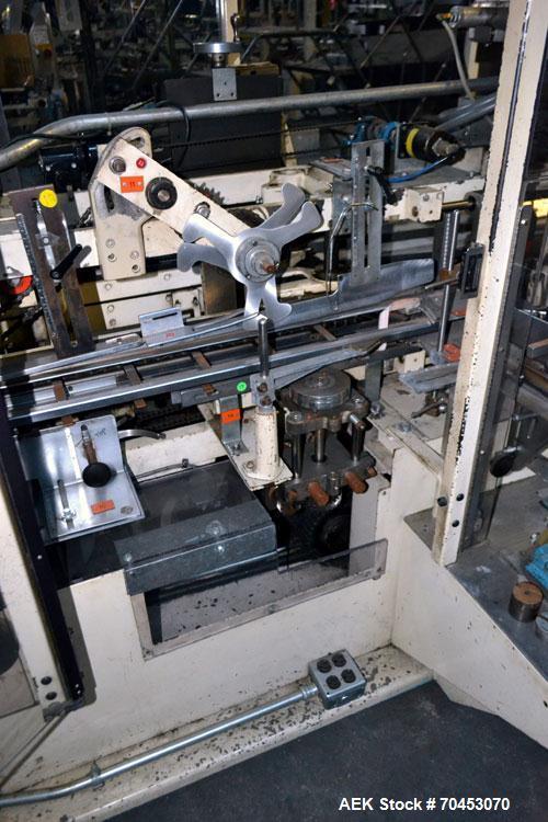 Used- Jones Model CMV5 Semi-Automatic Tuck Vertical Cartoner. Machine is capable of speeds up to 120 cartons per minute. Has...