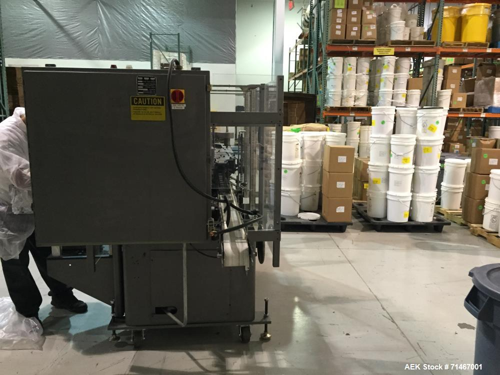 "Used- Jones CMV5 Semi Automatic Continuous Motion Vertical Hot Melt Tuck Cartoner. Capable of speeds up to 120 cpm. Has 5"" c..."