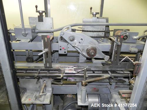 Used- Jones CMV8 semi automatic vertical cartoner, Model CMV8