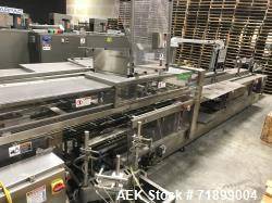 Used-Adco Vertical Cartoner, Model 9VHL-100-SS. Has automatic carton layflat magazine with rotary vacuum pick and place feed...