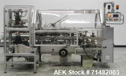 Used- CAM Model AV Vertical Cartoner With Automatic Bottle Loader