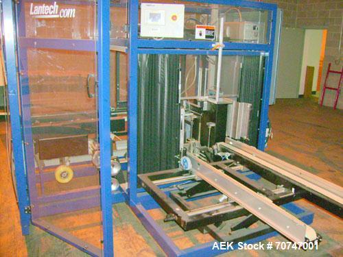 "Used-Lantech Case Erector, Model C-2000. Throughput speed 10-15 cases per minute. Case size minimum (OD) 7-7/8"" long x 5-7/8..."