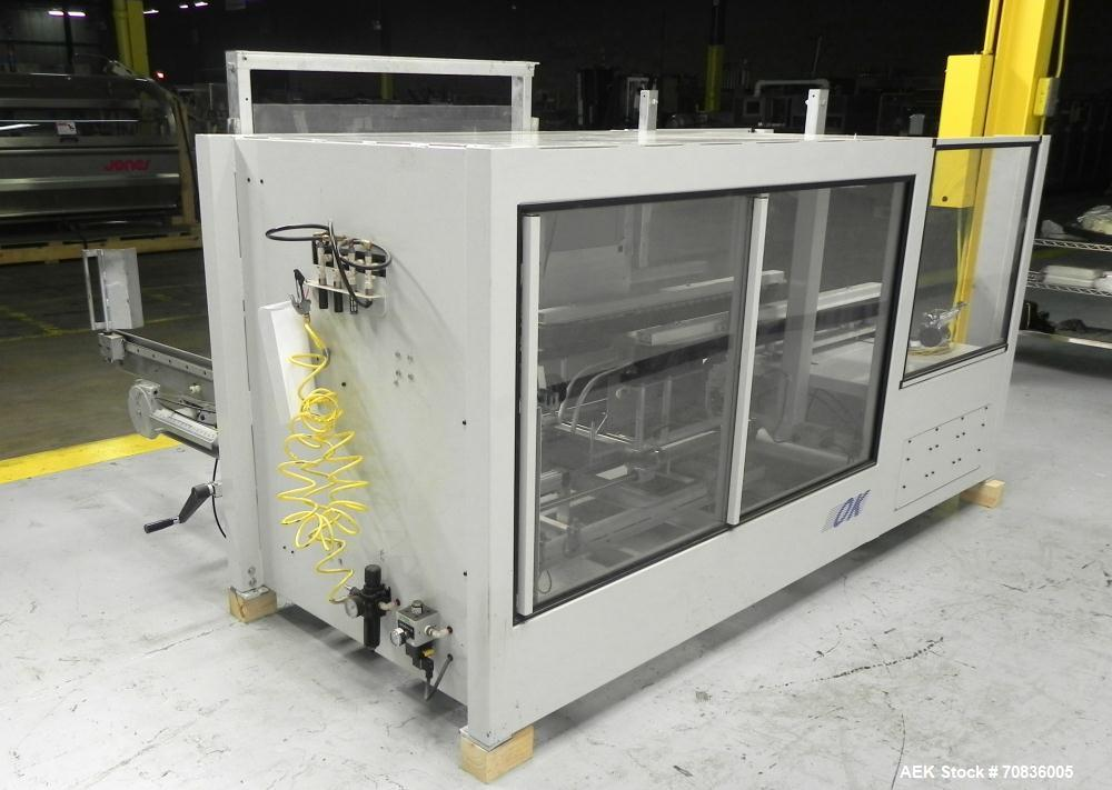 Used- OK International Model Duraformer 2 Automatic Case Erector and Bottom Taper. Machine is capable of speeds up to 18 cas...