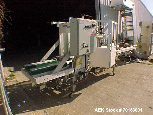Used-Wexxar Case Erector Model ABF.T. Machine is rated at 20 cases per minute. Wexxar has Allen Bradley SLC-500 progamable c...