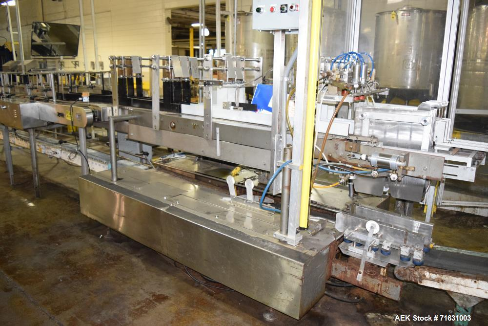 Used-Akron Spartan Drop Case Packer, S/N 5P 7078 with Nercon 2-Lane Combining Conveyor, Drives, *Incomplete controls*.