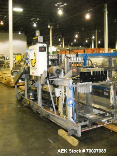 Used- Hartness, Model 825 Case Packer. Approximate production rate: 30 CPM depending on case and product container applicati...