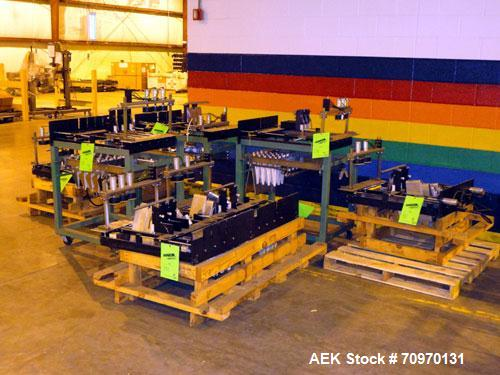 Used- Hartness International 825AT Case Packer Change Parts. Consisting Of: 3 skids, 3 carts. 580cc (12pk), 1875cc (6pk.), 8...