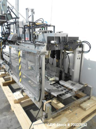 Used- Hartness, Double Head Drop Casepacker, Model 850. Stainless steel frame machine with dual drop heads which pack two ca...