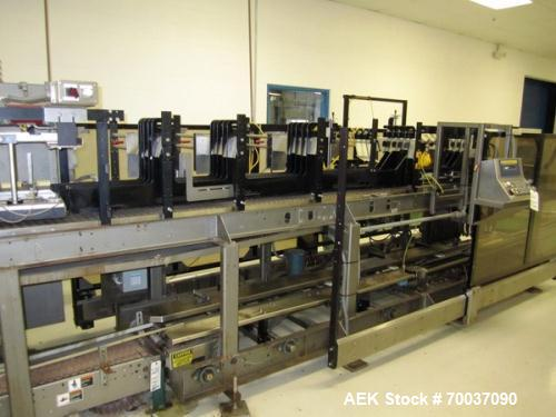 Used- Hartness Case Packer with Infeed Laner, Model CP900/825. Servo controlled lowering head drop packer capable of speeds ...