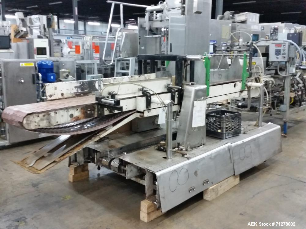 Used-Meyer Model M drop case packer. Capable of speeds up to 15 cases per minute. Currently set up on square gallon water bo...