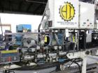 Used- Hartness, Case Packer with Infeed Laner, Model 825. Lowering head drop packer capable of speeds up to 30cpm. Infeed la...