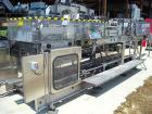 Used-Hartness Model 825 Fully Auto Case Packer with all stainless steel frame.Unit has been recently upgraded from factory w...