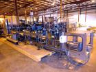 Used- Hartness 900 automatic drop case packer capable of speeds up to 25 cases per minute (depending on product and applicat...