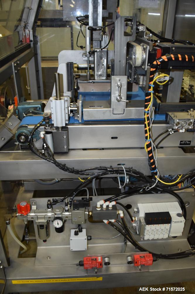 Used- BluePrint Automation Robotic Top Loader, Serial# 597, Job# 13129, Built 2002. Includes infeed product conveyor, and a ...