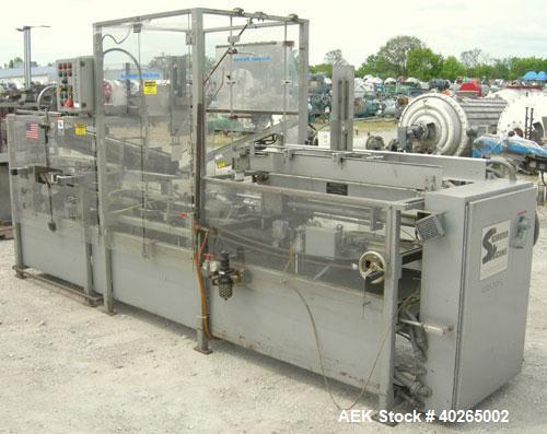 Used- Schroeder 1000 Quadnumatic Case Packer Erector and Sealer. Rated up to 12 cases per minute. Has Nordson hot melt glue ...