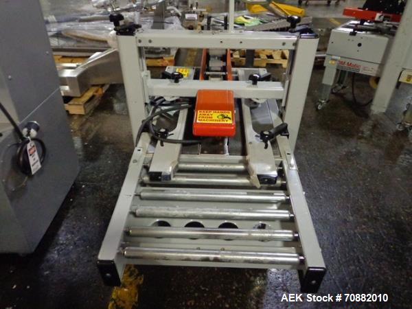 "Used- 3M Model 200A, Type 19000 Top and Bottom Adjustable Case Sealer. Up to 40 cases per minute, minimum case size 6"" wide ..."