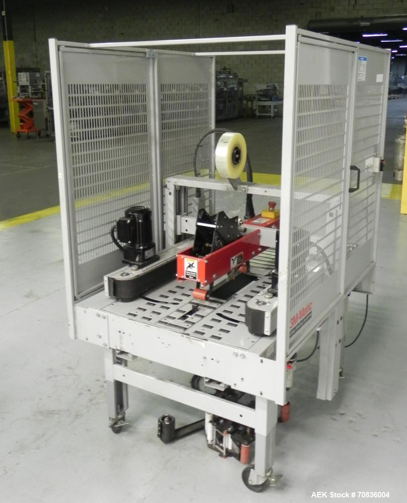Used- 3M-Matic Model 800R Random Adjustable Case Taper . Capable of speeds up to 15 cases per minute. Case size range: (widt...