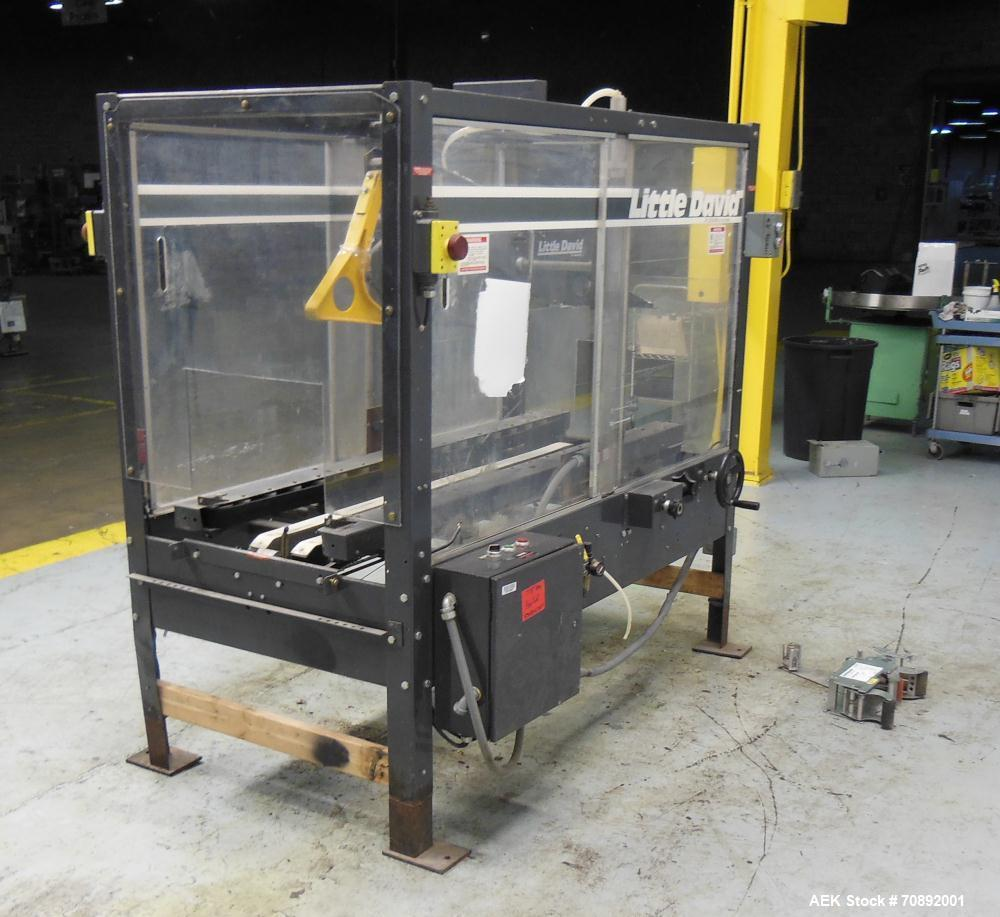 Used- Loveshaw Little David Model LD16A Top and Bottom Automatic Case Sealer. Missing (1) tape head. Capable of speeds up to...