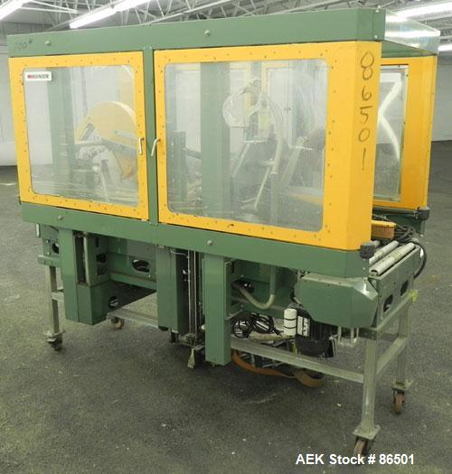 Used- Signode Fully Automatic Gemini Top and Bottom Case Taper, Model RCS-1020-1, Carbon Steel. (2) Model H3275I tape heads,...