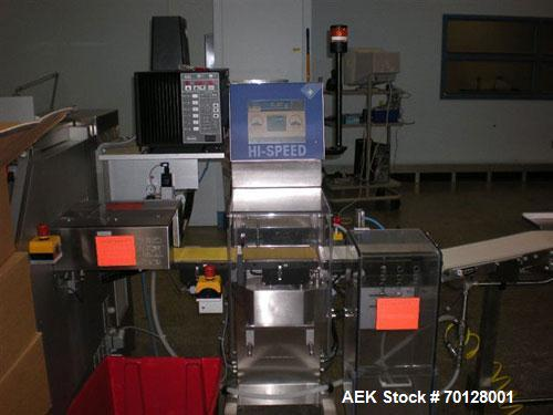 Used- Garvens RX2 Belt Checkweigher. Capable of speeds up to 400 ppm. Has weight range: 6g to 600g with accuracies of +/- 50...