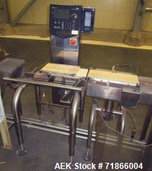 Used-Ishida Model DACS-G-S015-13/SS-I-S automatic belt checkweigher. Load cell up to 1500 gram weighing capacity. Has reject...