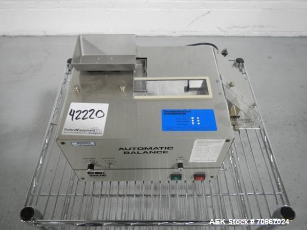 Used- Mocon Automatic Balance Checkweigher with Mocon automatic sorter, model AB-Plus Master, speeds from 20-45 units/minute...