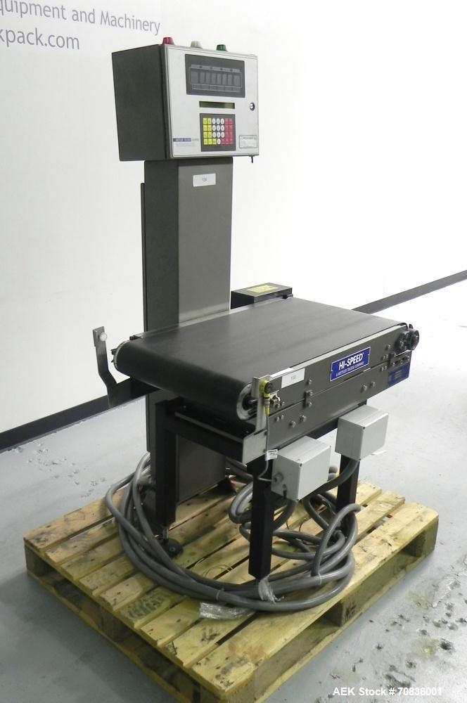 "Used- Mettler-Toledo Hi Speed Model Micro Mate CS3400GI-MM Case Checkweigher. Has a 18"" wide x 33"" long belt conveyor. Weigh..."