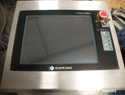 Used-Domino S300 Plus Purple Laser Coder, capable of producing two lines of code in excess of 1000 bottles per minute. Laser...