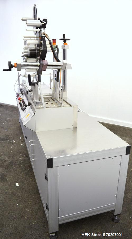 "Used- Metronic Peel Plate Labeling Machine, Type UDA 150 S. Approximate 4-1/2"" web width. Right to left operation, top down ..."