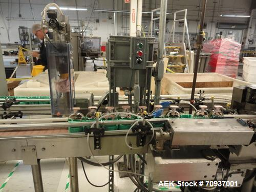 Used- MRM Elgin Complete Fragrance / Cosmetic Bottle Filling and Packaging Line. Consists of an MRM/Elgin 8 head rotary vacu...
