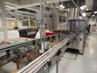 Used-US Bottlers Complete Fragrance / Cosmetic Bottle Filling and Packaging Line. Consists of a US Bottlers 28 head rotary v...