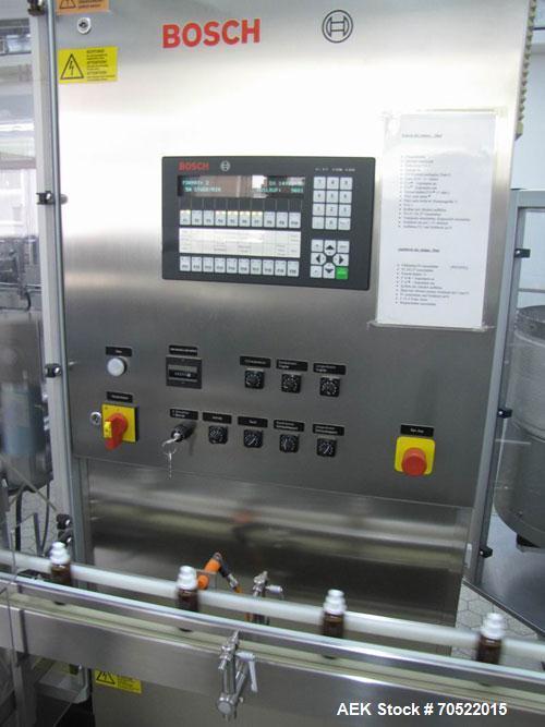 Used-Bosch MRF 1010 Bottle Filling/Closing Machine. Filling range 0.1 - 8.5 fl oz (0.5 - 250 ml), output 3,000 bottles an ho...
