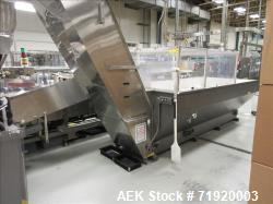 Used-Complete Serac RT18 Net Weigh High Speed Lotion Filling line. Consisting of Hoppmann Model FL100 bottle unscrambler wit...