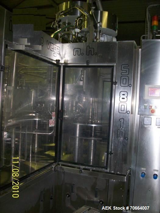 Used-Samci PET Triblock Rinser-Filler-Capper. 50 Rinsing heads, 80 valves. Capacity 23,000 bottles/hour x 500 ml. Capacity 2...