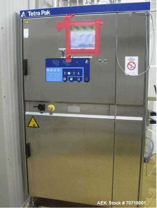 Used-Tetra Pak Tetra Top TT3 Filling Machine.  Maximum capacity 9,000 packages per hour, package sizes 0.13, 0.19 and 0.26 g...