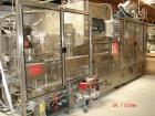 Used- Krones Starmatic 62 Head Monoblock Liquid Bottling Line. Includes General Machinery caser and conveyors.