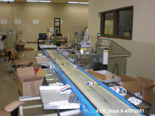 "Used: Island pack off conveyor. Unit is 20' long with 12"" wide neoprene belt. M/S frame with stainless steel side tables. La..."