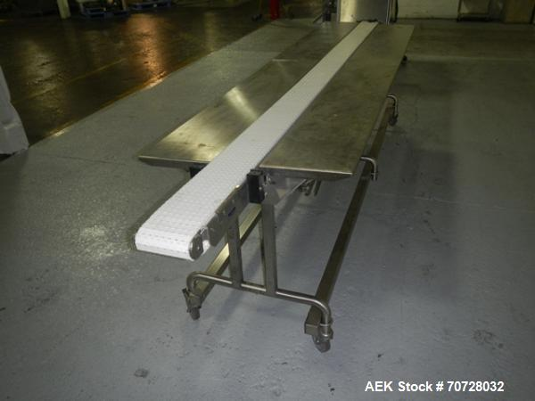 "Used- Pack off conveyor, 6"" wide x 11' long slat conveyor, 12"" stainless steel side extensions, .13 hp dc motor drive on sta..."