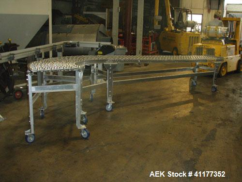 Used- Dead Case Roller Conveyor. 90 degree turn. All stainless steel frame mounted on casters.