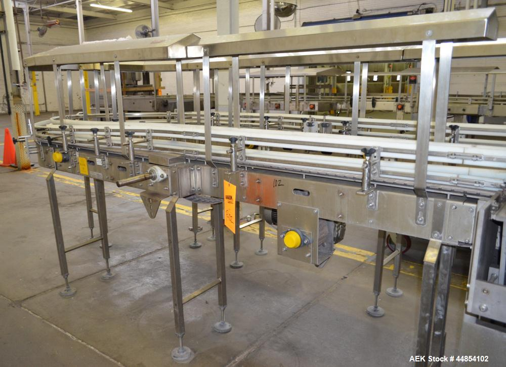 "Used- Table Top Belt Conveyor. Approximately 4"" wide x 1072"" long, partial belt.  Stainless steel frame.  Includes (11) turn..."