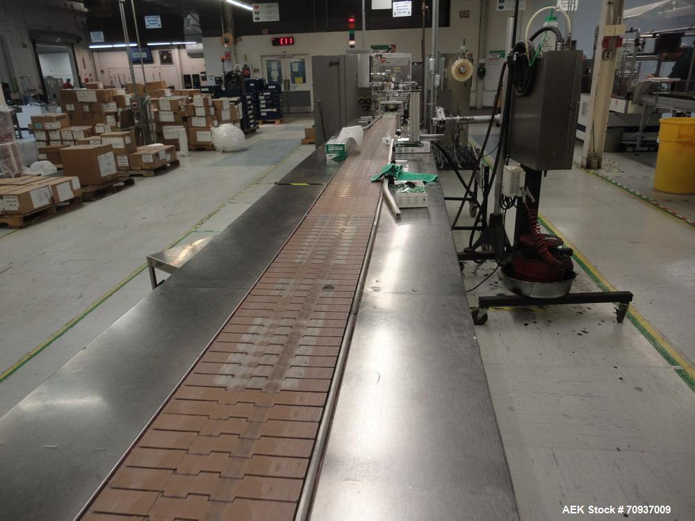 "Used-Pack Out Conveyor, 30 feet long (approximately) by 12"" wide tall table top chain, with dual stainless steel side pack o..."