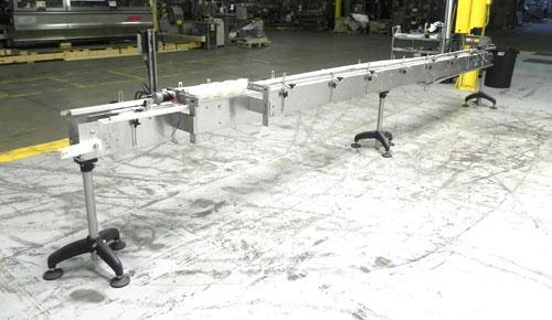 "Used- Inline Filling Systems Table Top Belt Conveyor. 256""L (21"" 4""L) x 4-1/2"" w delrin TT chain. Includes a 3/4 hp DC motor..."