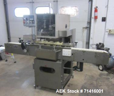 Used- Lasko Single Head Station Cottoner, Model 150. Machine is capable of speeds up to 150 bottles per minute.