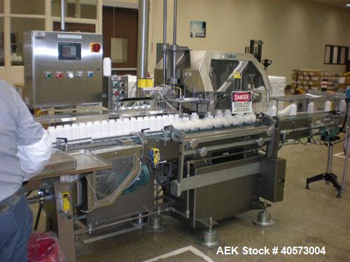 Used- Lakso Model 71 Automatic Twin Head Cottoner capable of speeds up to 200 BPM. Has screw infeed automatic bottle. Has fa...