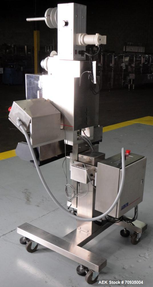 Used- AZCO model SP-110 Sur-Pak Desiccant pouch dispenser. Rated speeds up to 200 cuts/minute, depending on size of pouch. D...